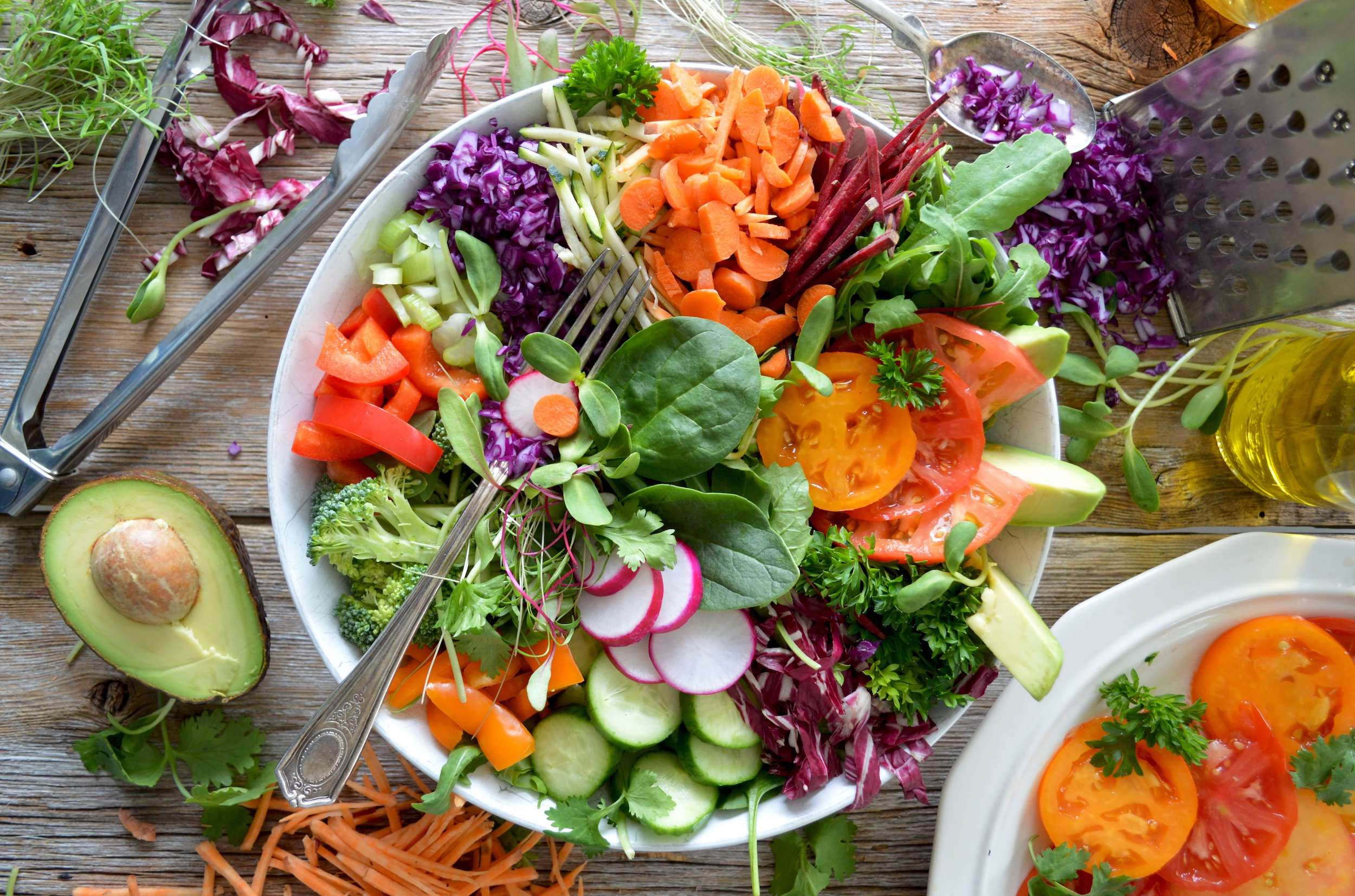 Plate of colourful vegan food and colourful salad