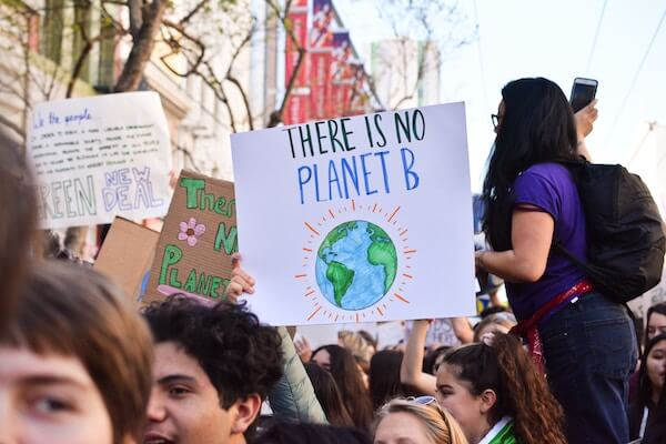 Marching to support going vegan for the environment - a sign reading there is only one planet