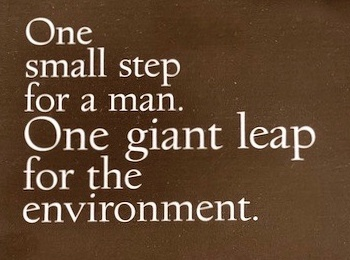Nae vegan boots box saying 'One small step for a man. One giant leap for the environment'.