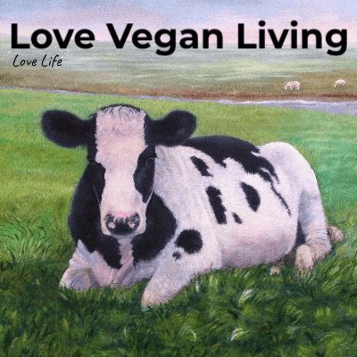 Picture of black and white cow with Love Vegan Living written above it