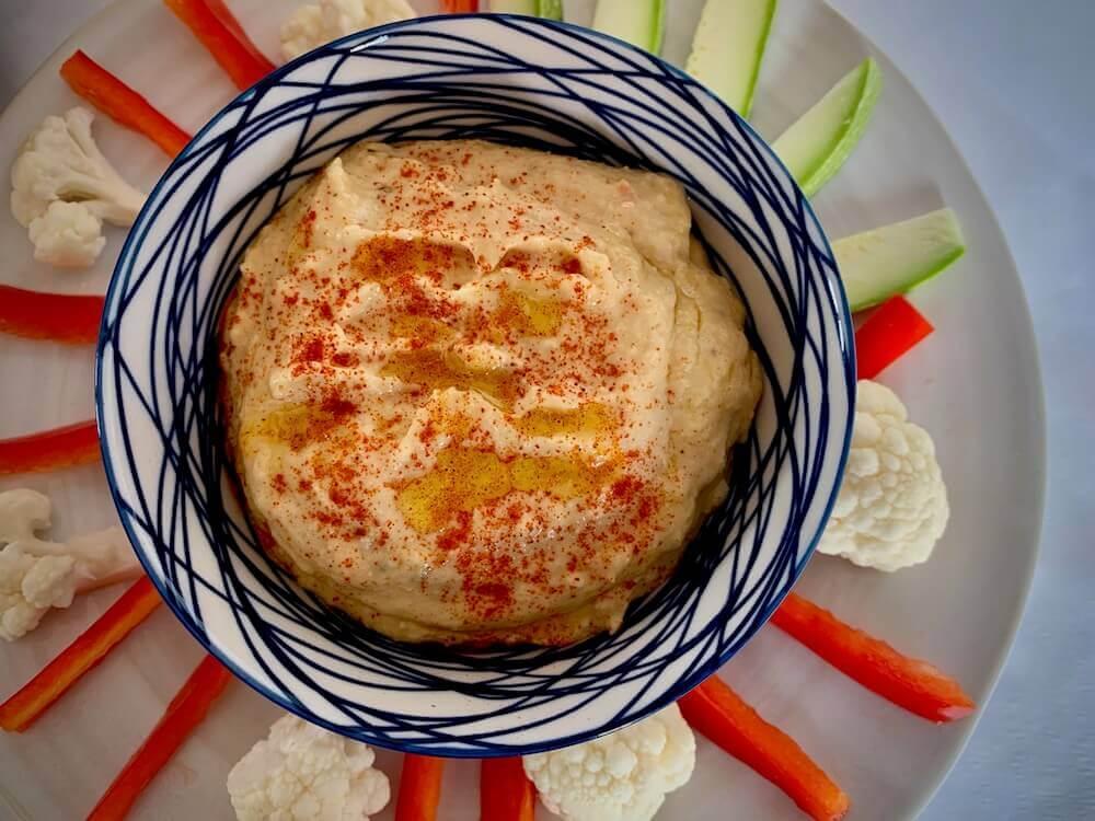 Bowl of hummus with crudités