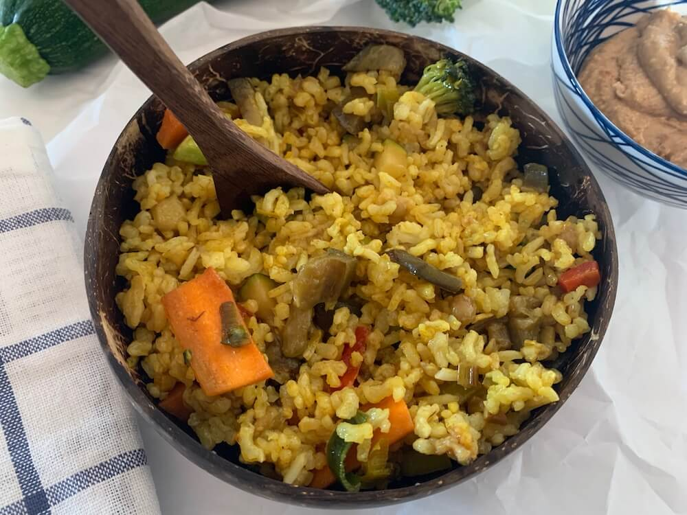 Bowl of vegan rice with vegetables