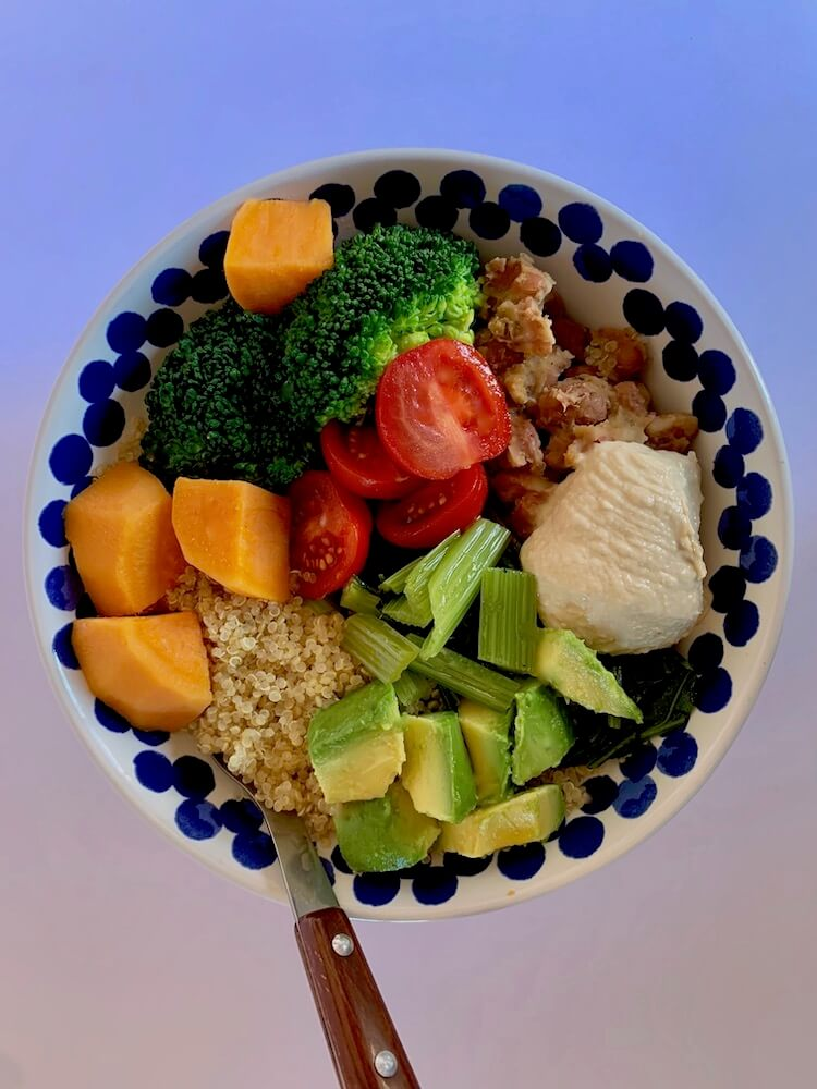 Vegan buddha bowl with quinoa, broccoli and sweet potato