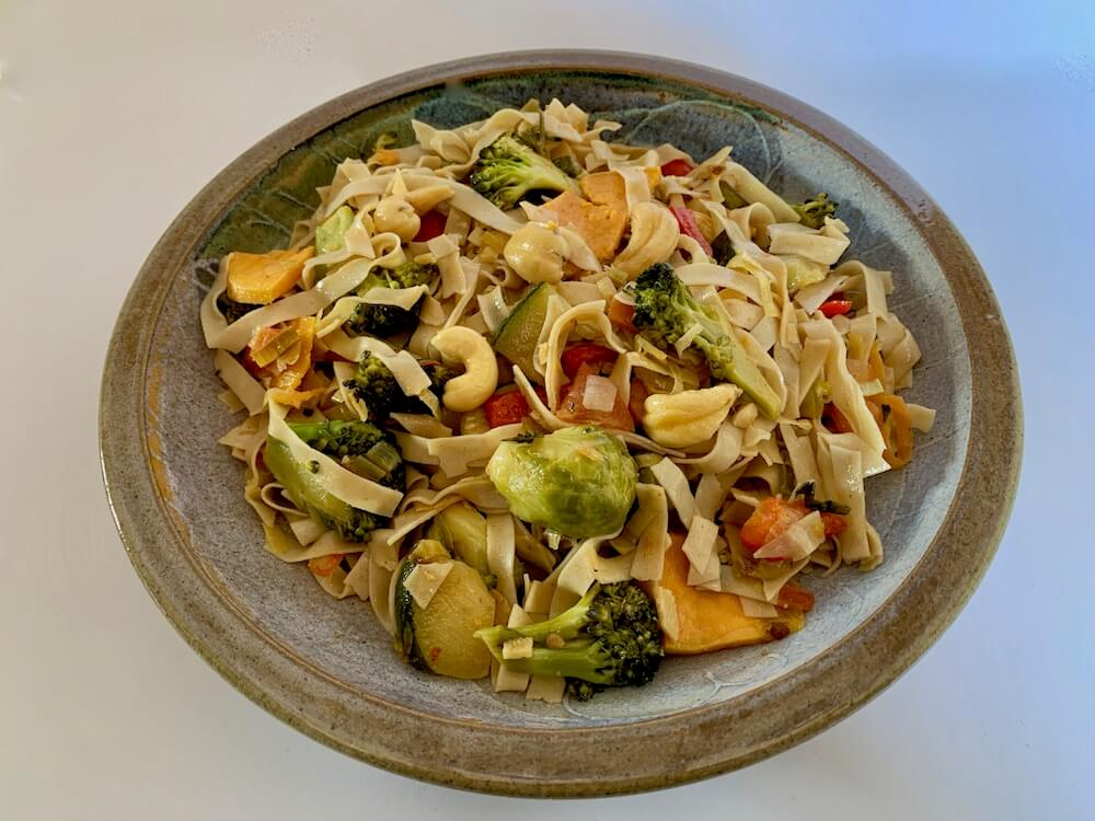 Plate of gluten free noodles with vegetables