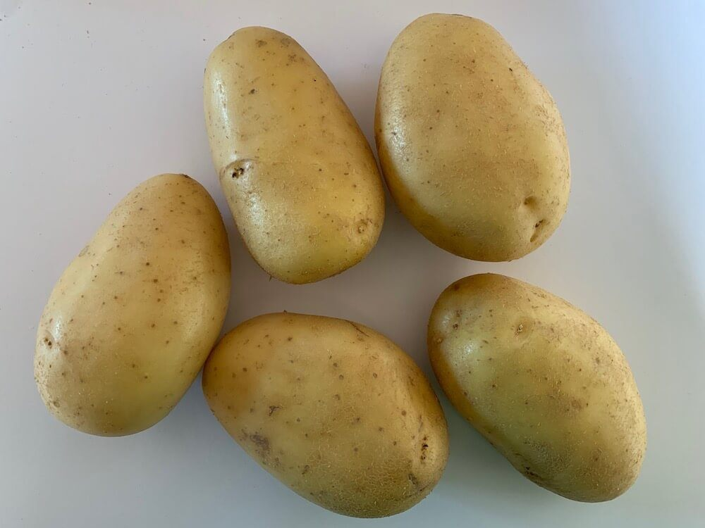 Washed, raw potatoes