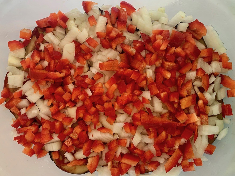 Finely chopped red pepper on vegan eggplant recipe