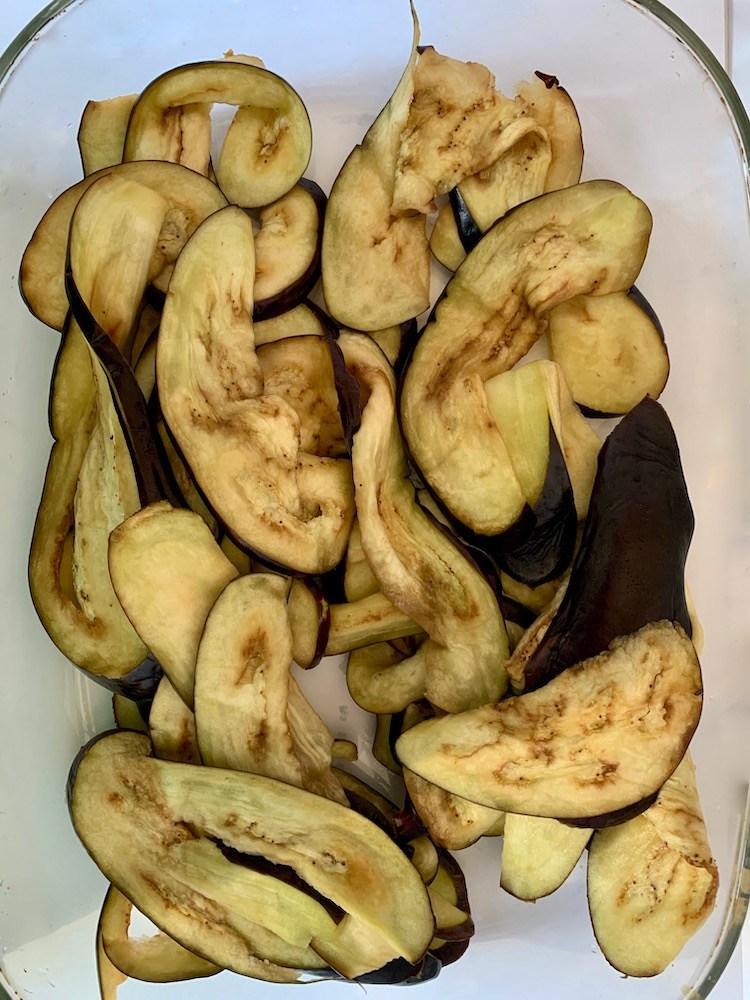 Rinsed slices of eggplant