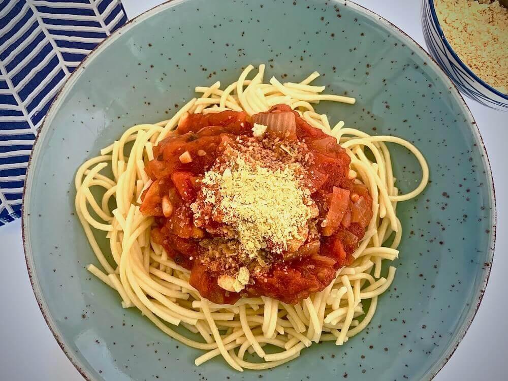 Vegan parmesan on pasta pomodoro