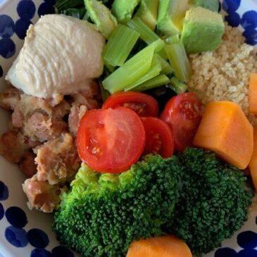 Vegan buddha bowl with quinoa, refried beans, broccoli and sweet potato