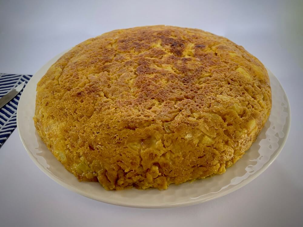 Whole vegan Spanish omelette on a plate