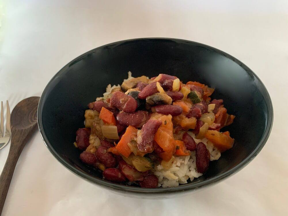Bowl of vegan chilli beans with rice