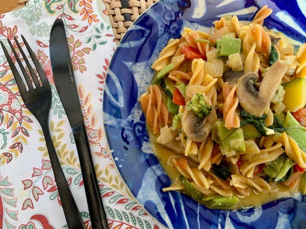Plate of creamy vegan vegetable pasta