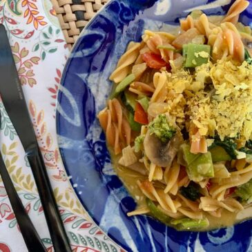 Creamy Vegetable pasta with nutritional yeast on top