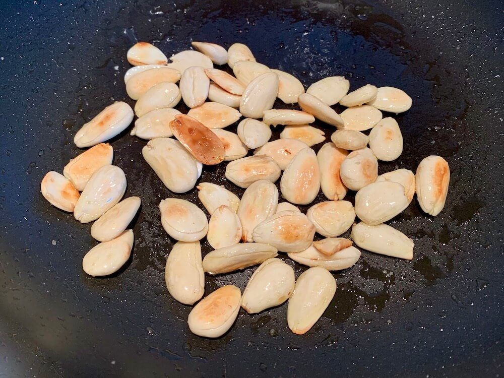 Frying almonds