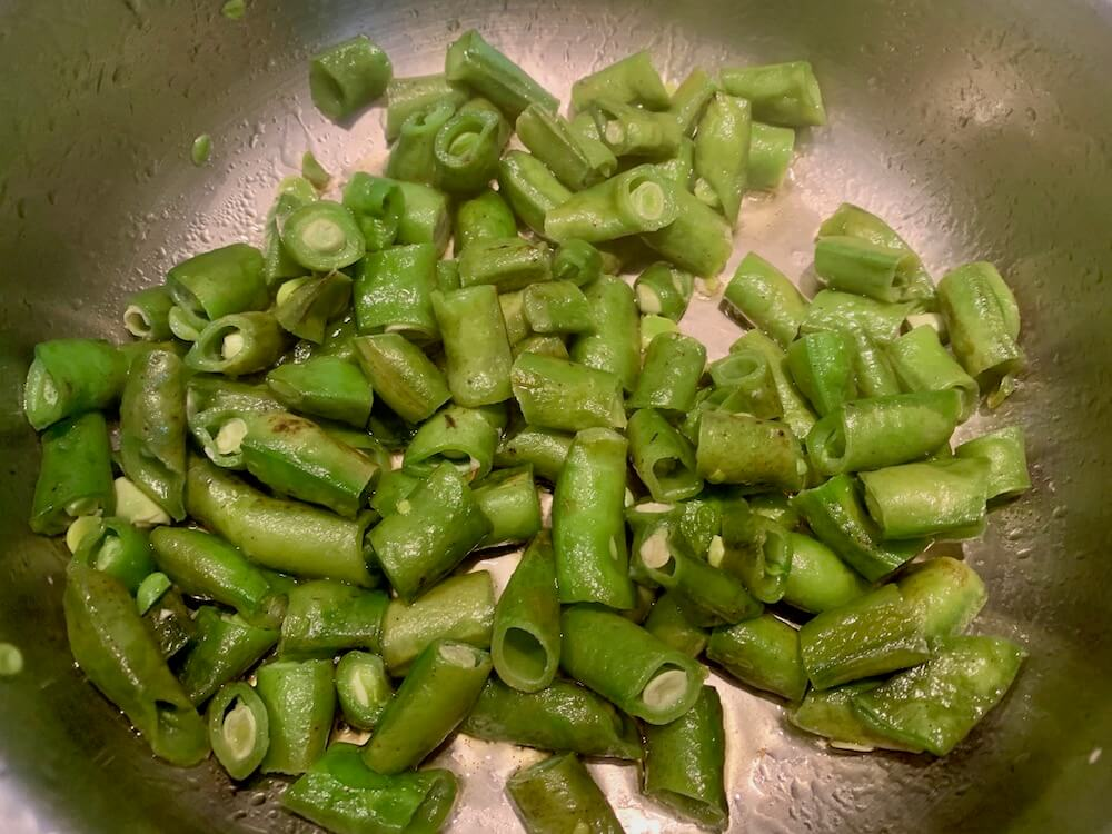 Frying broad beans