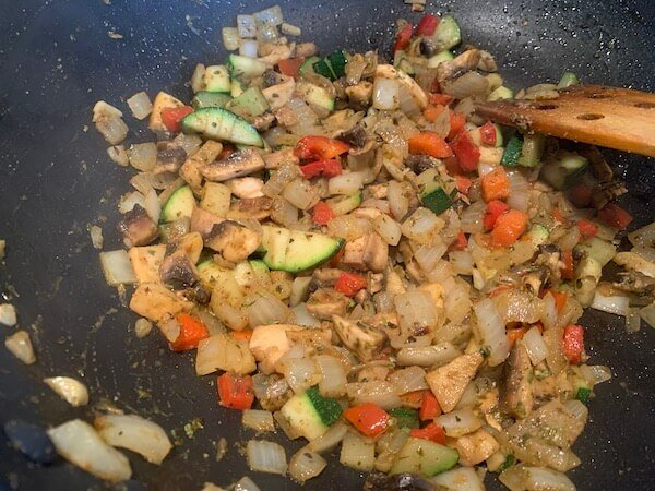 Frying onions, red pepper and mushroom for vegan chilli beans
