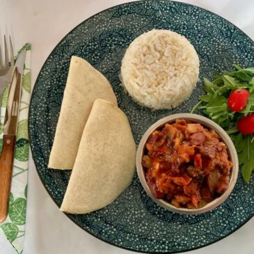 Plate with rice, GF wraps and a bowl of vegan chilli beans