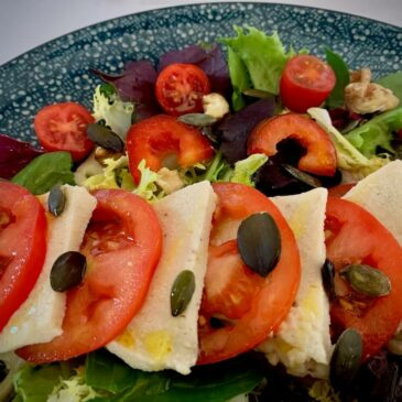 Close up of vegan mozzarella & tomato salad