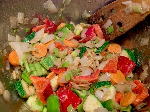 Frying vegetables for lentil stew