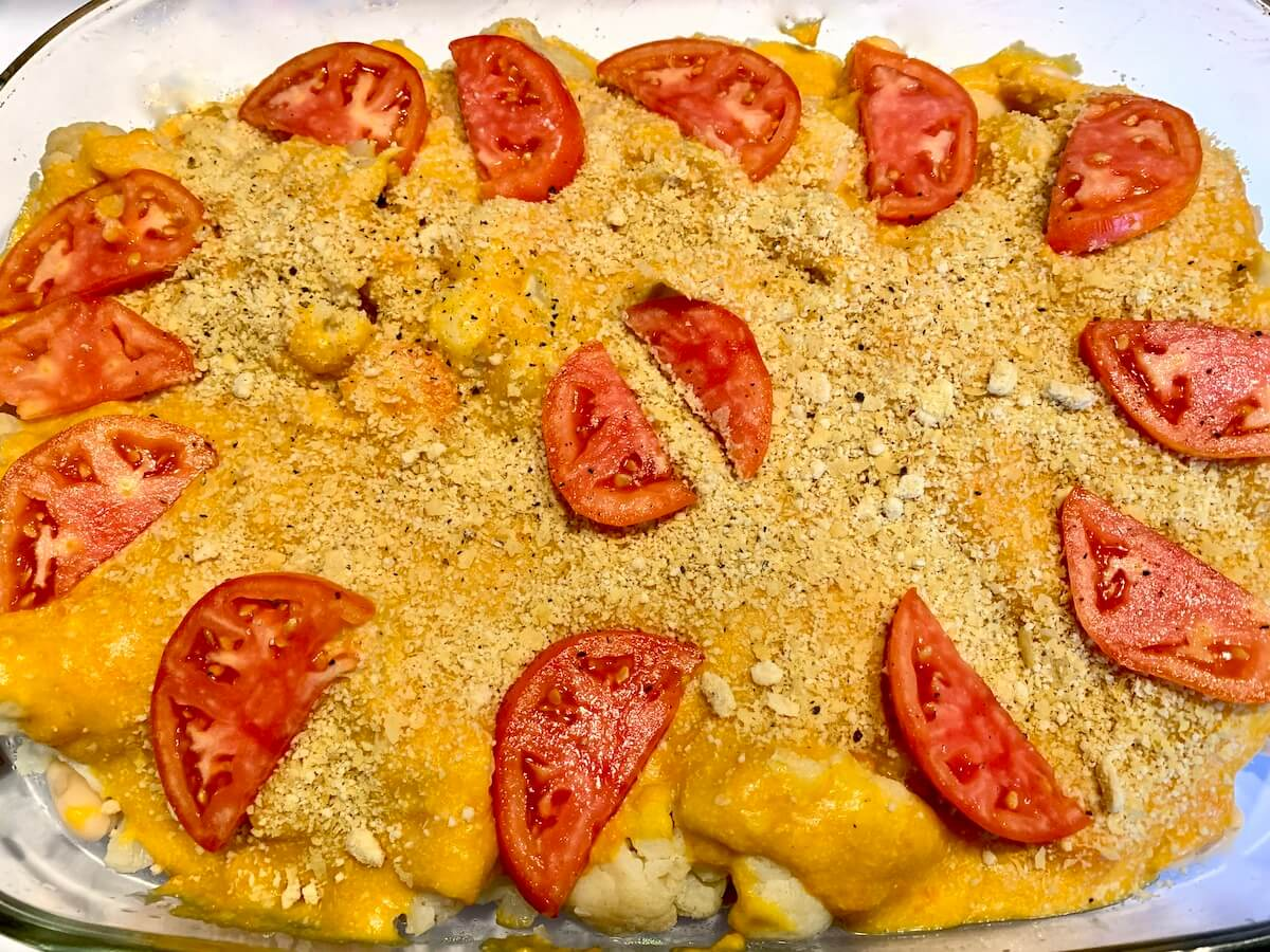 Vegan cauliflower cheese in a casserole before cooking