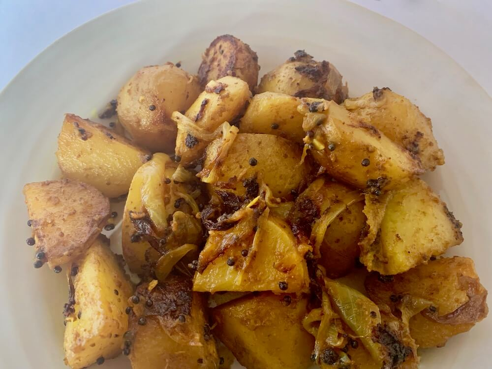 Potatoes cooked in turmeric