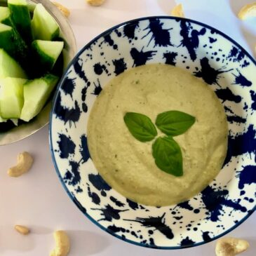 Bowl of vegan cashew sauce with basil & garlic