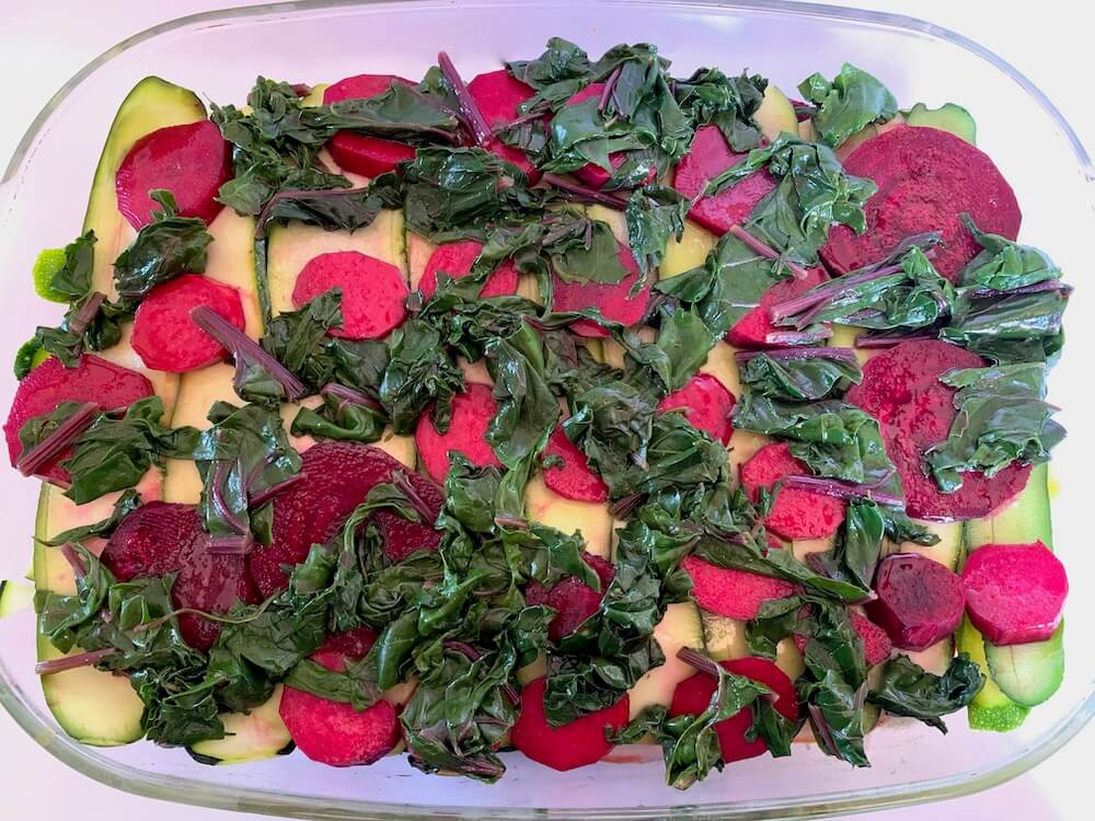 Spinach, beetroot and zucchini in a casserole dish