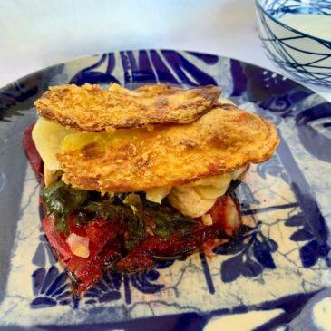 Slice of potato zucchini casserole with beetroot