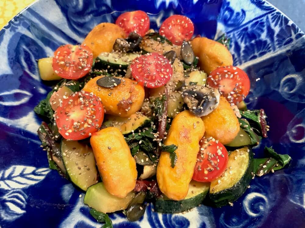 Homemade vegan gnocchi with fried vegetables