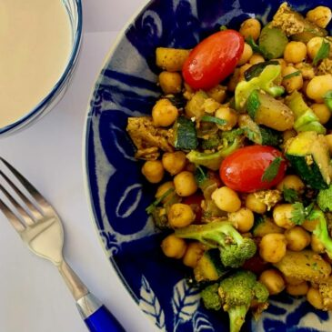 Bowl of quick chickpea recipe with broccoli & zucchini served with tahini sauce