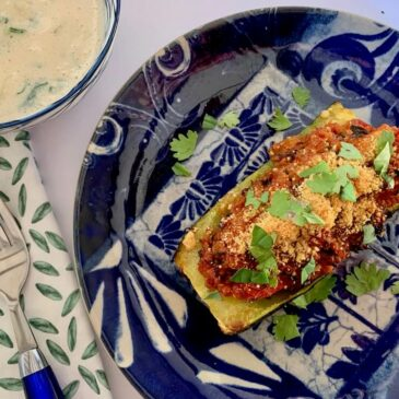 Vegan stuffed zucchini boat with vegan raita sauce