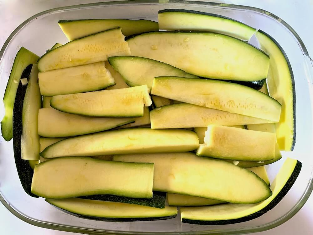 Sliced zucchini in a casserole dish