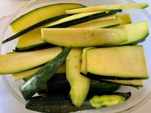 Thinly sliced zucchini in olive oil and garlic marinade