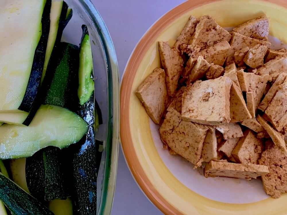 Sliced zucchini and marinated tofu