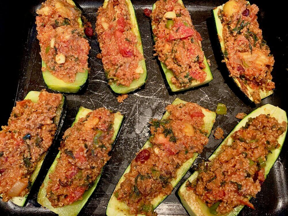 Quinoa and tomato stuffed zucchini boats
