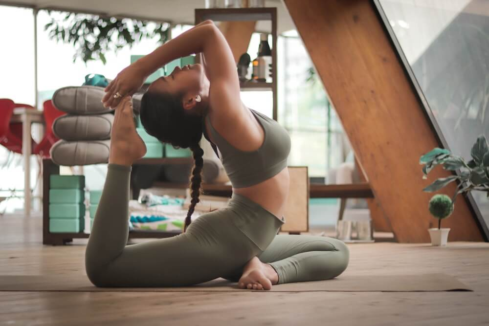 Flexible woman doing a yoga backbend