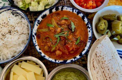 vegan chilli beans, rice, lettuce, tomato, vegan cheese, jalapeños and celery sauce to go in wraps