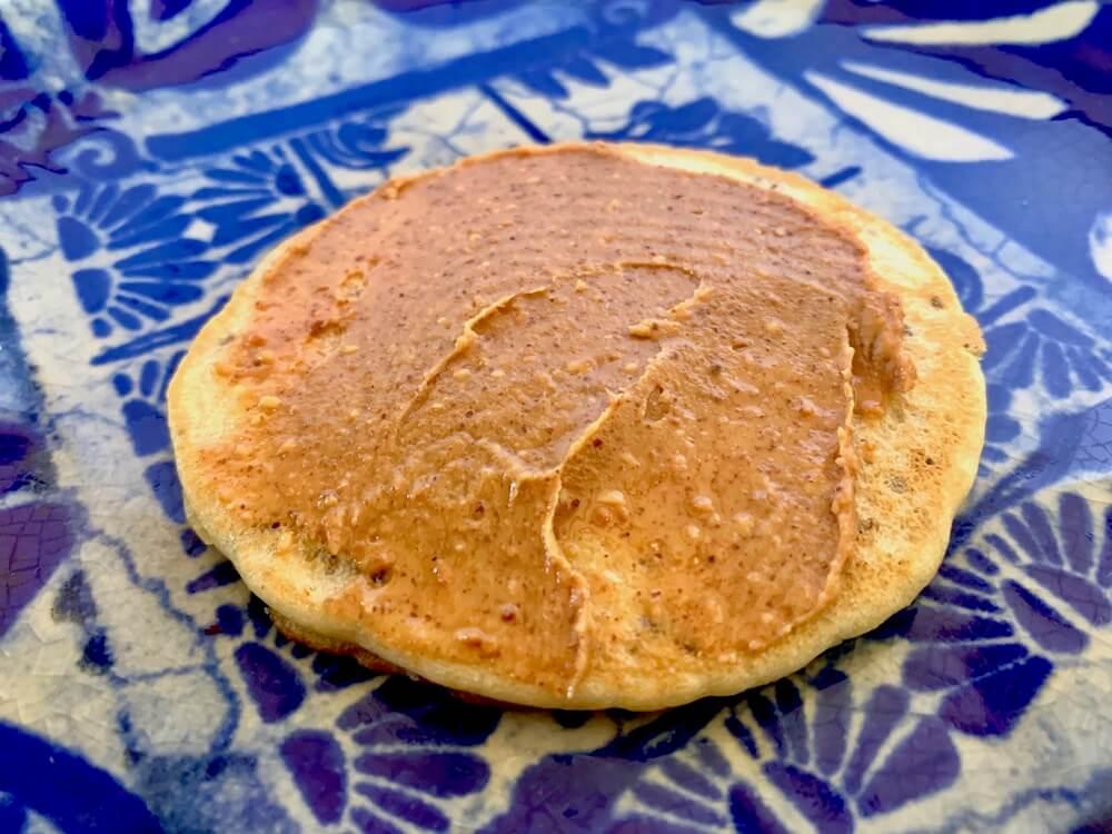 Gluten free vegan pancake with peanut butter on top