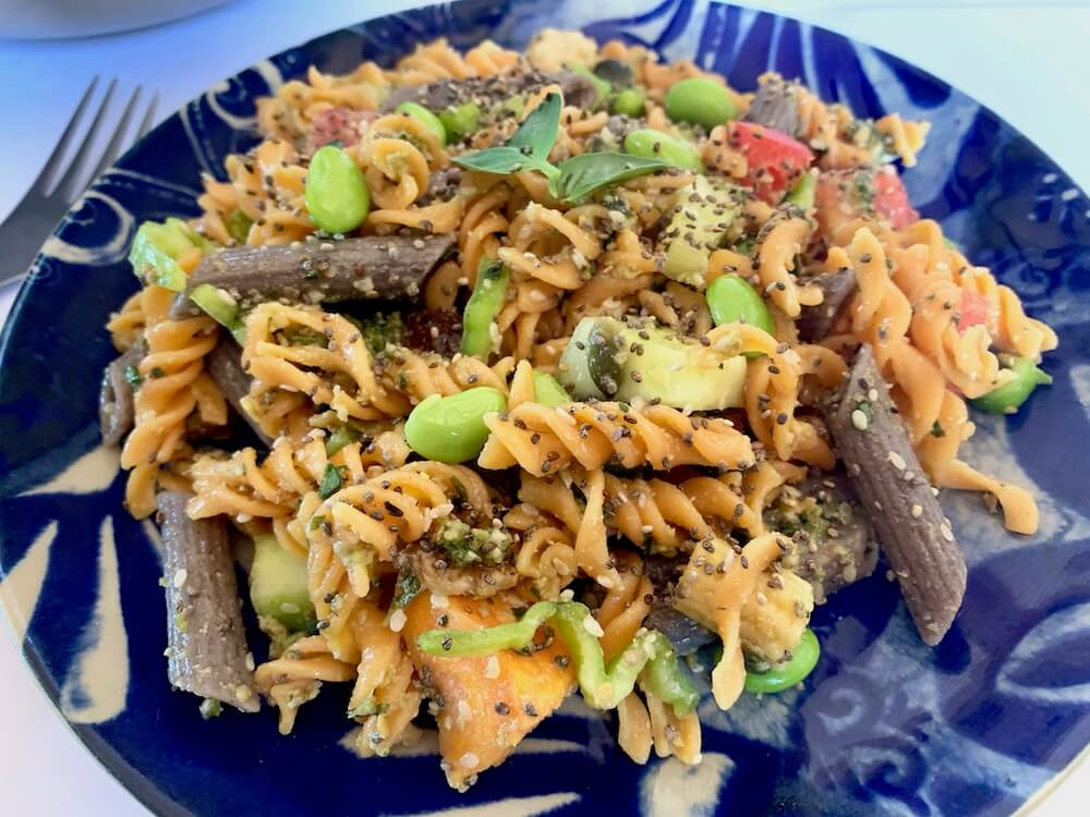 Gluten free pasta salad on a blue plate