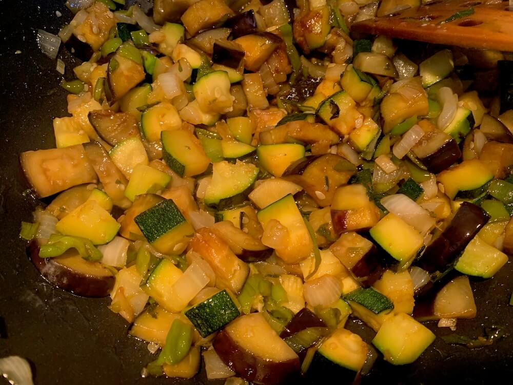 Vegetables for pisto frying in a pan