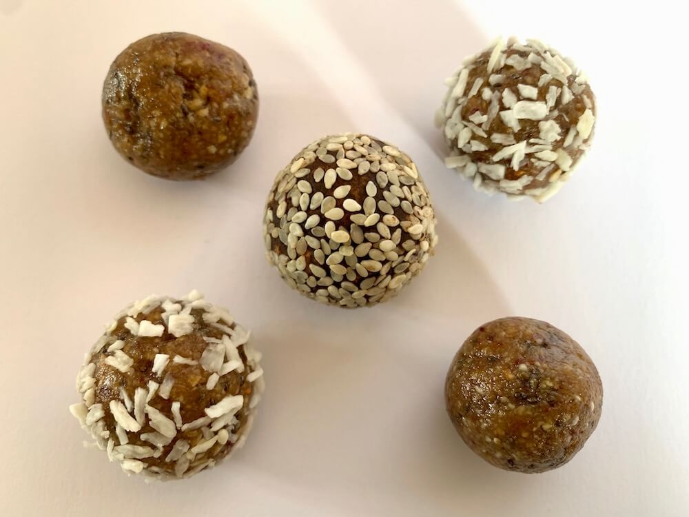 Three types of no bake protein energy balls: plain, coconut, and chocolate & sesame seed flavour