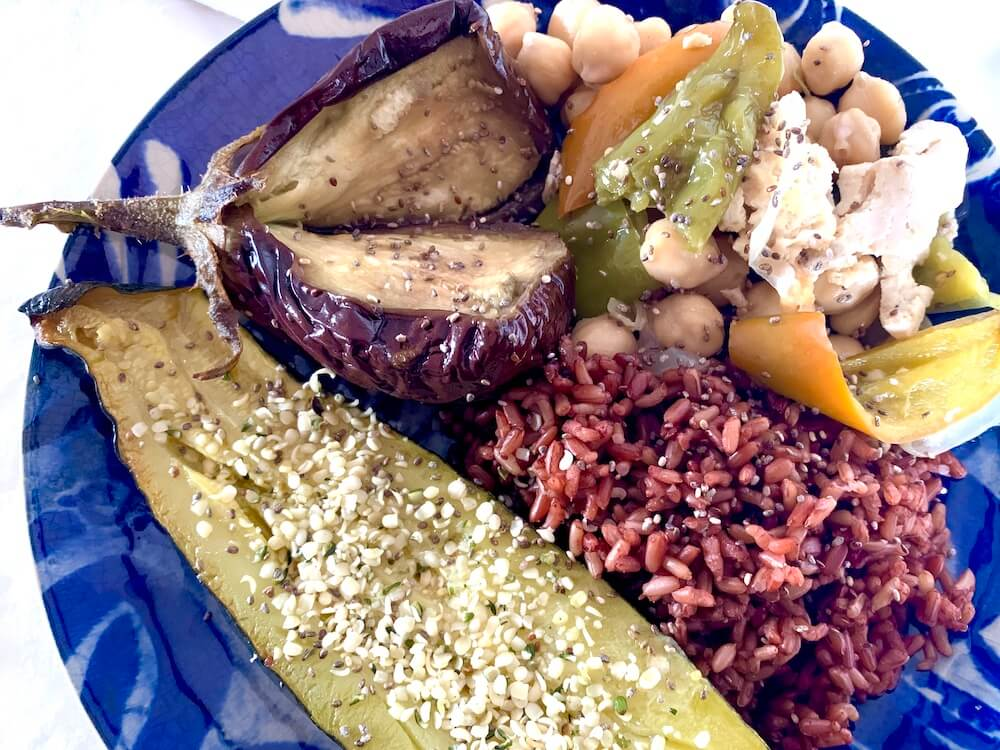 Roasted vegetables with red rice for a vegan dinner recipe