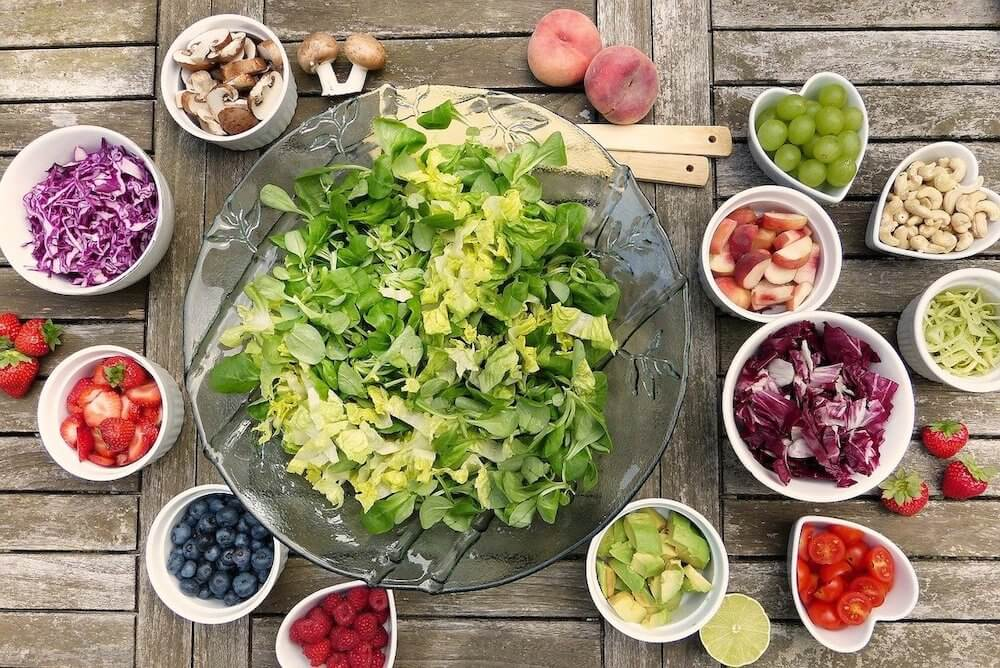 assortment of vegetables and berries and nuts for a plant based diet
