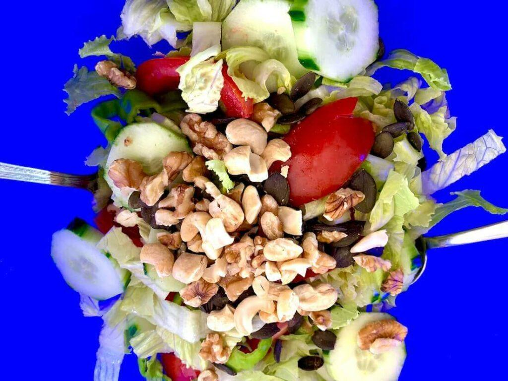 Blue background with salad