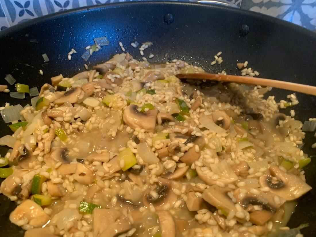 Liquid in the pan of rice and mushrooms