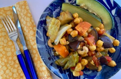 Blue plate with an assortment of oil free vegetables and roasted zucchini wedges