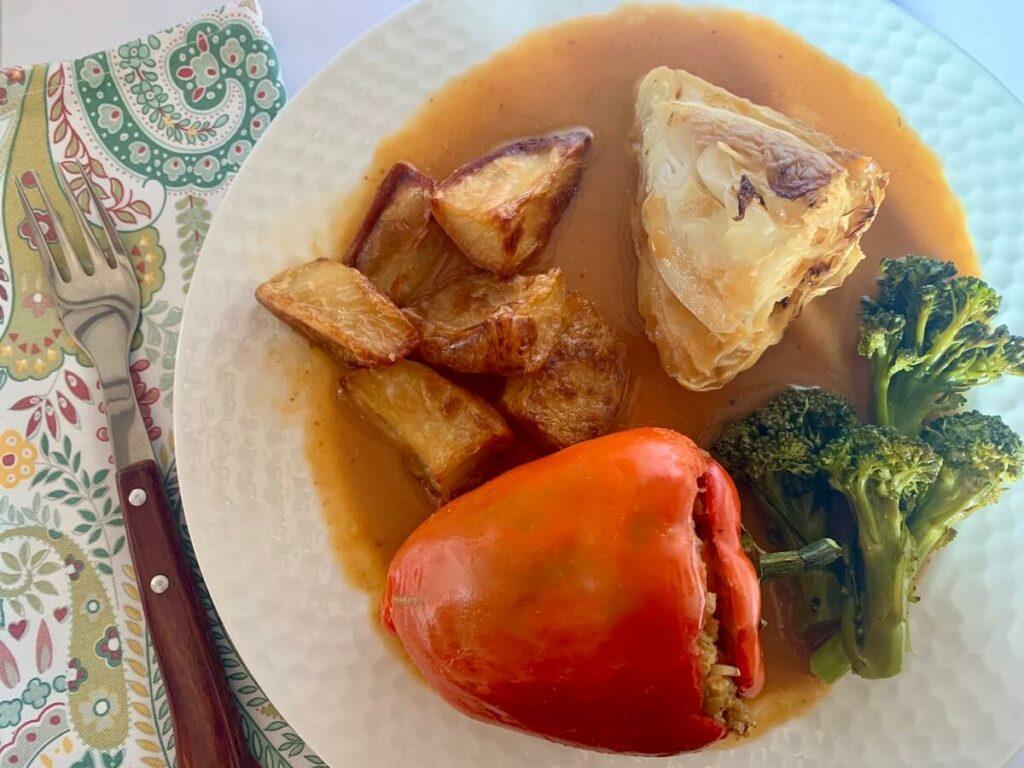 Stuffed red pepper, roast cabbage, roast potatoes, broccoli and gravy
