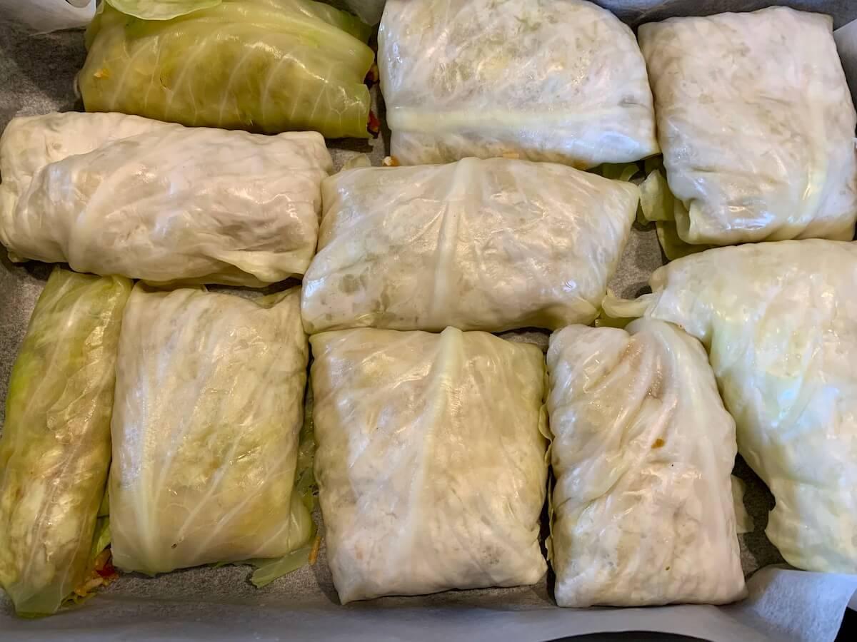 Pan full of vegan stuffed cabbage rolls