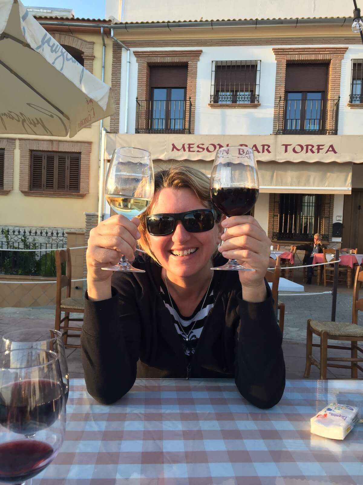 How to change your relationship with alcohol: woman holding up two glasses of wine