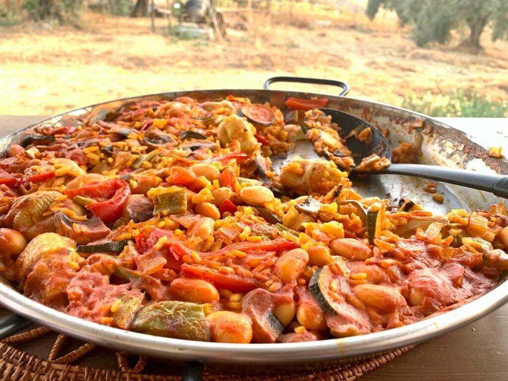 Paella on a table in the garden